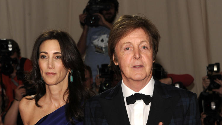 FILE - In this May 2, 2011 file photo, recording artist Paul McCartney, right, and Nancy Shevell arrive at the Metropolitan Museum of Art Costume Institute gala in New York. McCartney will be honored as MusiCares person of the year during Grammy week next year. (AP Photo/Evan Agostini, file)