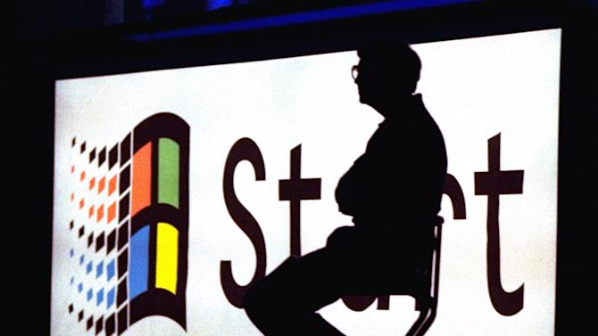 FILE - In this Aug. 24, 1995, file photo, Microsoft Chairman Bill Gates sits on stage during a video portion of the Windows 95 Launch Event  on the company's campus in Redmond, Wash. One of the biggest changes with Windows 8 is the disappearance of the familiar start button at the lower left corner of the screen. There will be a new screen filled with a colorful array of tiles, each leading to a different application, task or collection of files. (AP Photo/File)