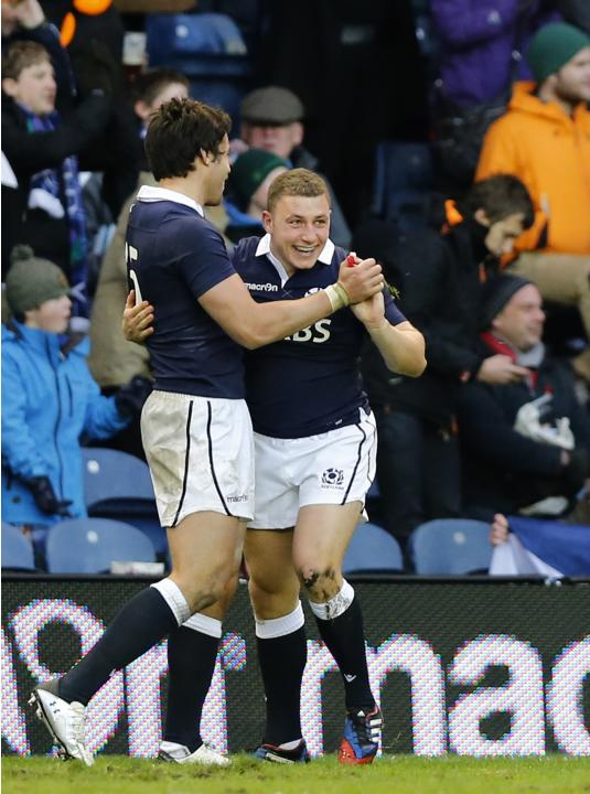 Scotland's Duncan Weir celebrates, with Sean Maitland, his try against Japan during their rugby union match at Murrayfield Stadium in Edinburgh