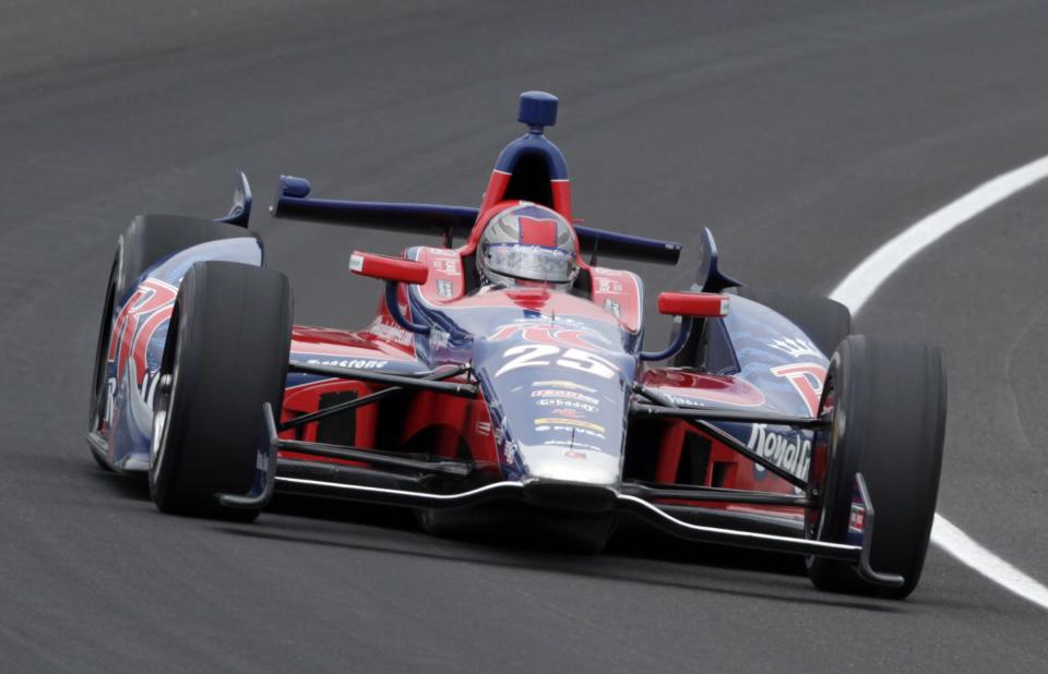Marco Andretti drives through the first turn during practice for the Indianapolis 500 auto race at the Indianapolis Motor Speedway in Indianapolis, Friday, May 17, 2013. (AP Photo/AJ Mast)
