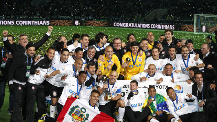 Corinthians players and team staff pose for a group photo during an award ceremony after beating Chelsea FC 1-0 in their final match to win the FIFA Club World Cup soccer tournament in Yokohama, near Tokyo, Sunday, Dec. 16, 2012. (AP Photo/Shizuo Kambayashi)