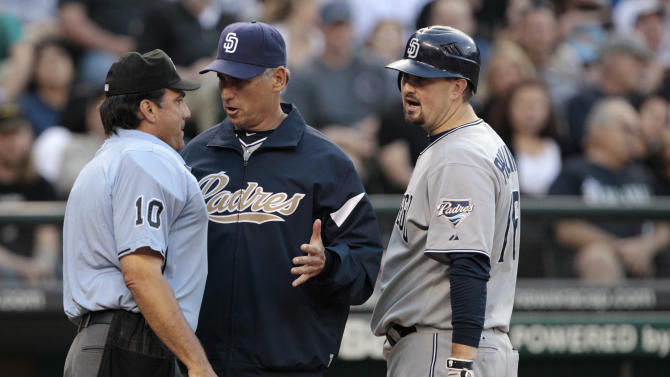 San Diego Padres manager Bud Black, center, argues with plate umpire Phil Cuzzi after Cuzzi called out Kyle Phillips on strikes against the Seattle Mariners in the fifth inning in a baseball game Saturday, July 2, 2011, in Seattle. (AP Photo/Elaine Thompson)