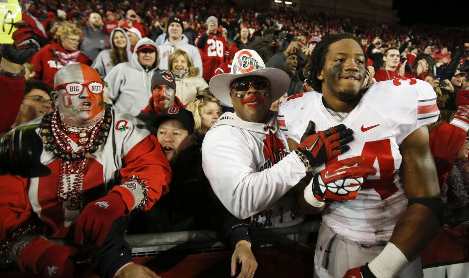 Ohio State fans celebrate with Carlos Hyde after the Buckeyes beat Wisconsin 21--14 in overtime in a college football game Saturday, Nov. 17, 2012, in Madison, Wis. Hyde had the game-winning touchdown. (AP Photo/Andy Manis)