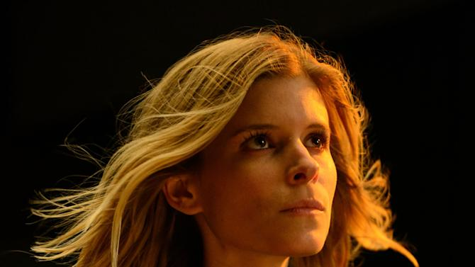 "This photo provided by Twentieth Century Fox shows, Kate Mara, as Sue Storm, in a scene from the film, ""Fantastic Four."" The movie opens in U.S. theaters on Aug. 7, 2015. (Ben Rothstein/Twentieth Century Fox via AP)"