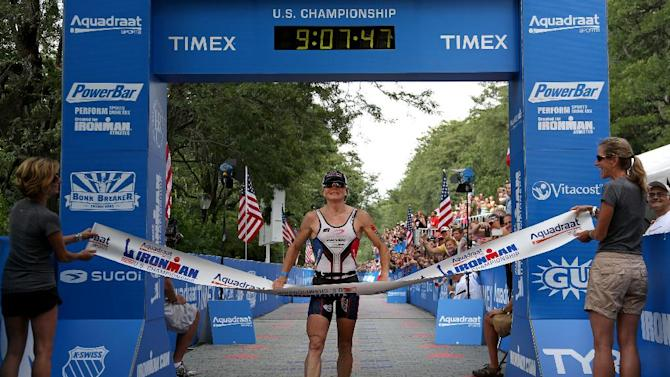Mary Beth Ellis crosses the finish line to win women's division of the Ironman U.S. Championship triathlon in New York, Saturday, Aug. 11, 2012. (AP Photo/Craig Ruttle)