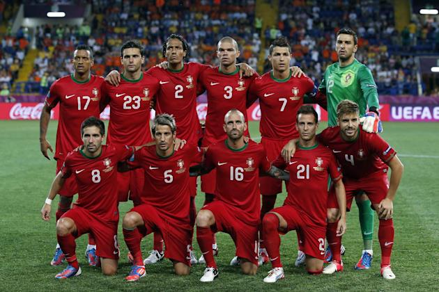 In this June 13, 2012 file photo, Portugal soccer team poses prior to the start the Euro 2012 soccer championship Group B match between Portugal and the Netherlands in Kharkiv, Ukraine. Background fro