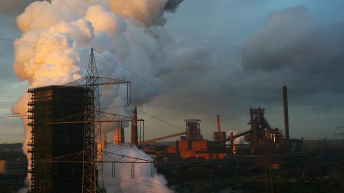 File photo of steam rising at coking plant at steelworks of ThyssenKrupp AG in Duisburg