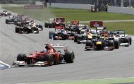 Spain's Ferrari driver Fernando Alonso, left, leads the field right after the start of the German F1 Grand Prix in Hockenheim, Germany,  Sunday, July 22, 2012. (AP Photo/Frank Augstein)