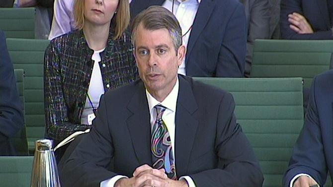 In this image made from video, Google Vice President Tom Hutchinson, giveS evidence to the British government Commons Public Accounts Committee in London, Thursday Feb. 11, 2016.  Google executives are appearing before the British government committee following controversial agreements over tax payments by the internet giant.  (Image from video / PA via AP) UNITED KINGDOM OUT - NO SALES - NO ARCHIVES