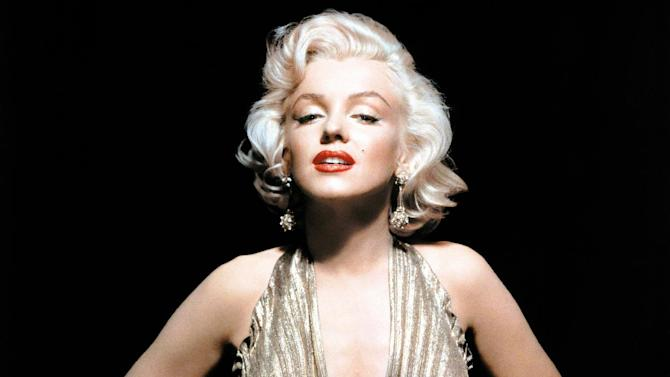 "In this undated publicity photo courtesy Running Press, Marilyn Monroe is shown wearing a knife-pleated gold lamé gown made from ""one complete circle of fabric."" She wore this dress in ""Gentlemen Prefer Blondes."" Monroe passed away a half-century ago this week, a murky death that remains one of Hollywood's most tantalizing mysteries. But look around: Her legend lives on, more vibrantly than ever. In a twist she surely would have appreciated, this 1950's bombshell has become a 21st-century pop culture phenom. (AP Photo/Courtesy Running Press)"