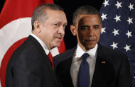 U.S. President Barack Obama, right, stands with Prime Minister of Turkey Recep Tayyip Erdogan during their bilateral meeting in Seoul, South Korea, Sunday, March, 25, 2012. (AP Photo/Pablo Martinez Monsivais)