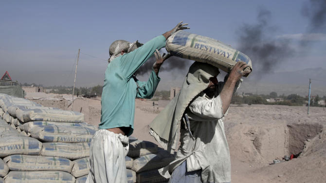 Afghan men work at a brick factory in Surkh Rod, district of Nangarhar east of Kabul, Afghanistan, Thursday, Nov. 15, 2012. Men work at the factory 8 hours a day for about $USD 9. (AP Photo/Rahmat Gul)