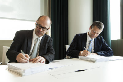 Karl Eichinger, Chief Financial Officer of Sapa, and Arne Norheim, Country General Manager for IBM Norway, sign deal in Oslo, Norway.