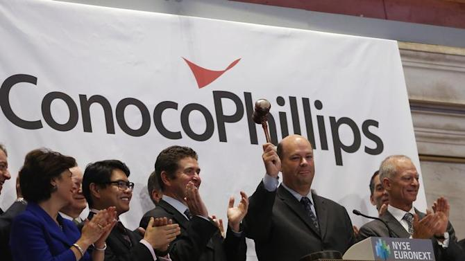 ConocoPhillips Chairman and CEO Lance rings the closing bell at the New York Stock Exchange