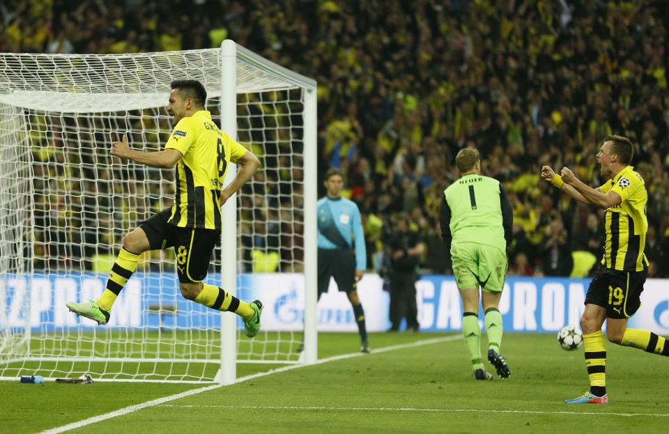 Dortmund's Ilkay Guendogan, left, reacts after scoring his side's first goal, during the Champions League Final soccer match between Borussia Dortmund and Bayern Munich at Wembley Stadium in London, Saturday May 25, 2013. (AP Photo/Kirsty Wigglesworth)