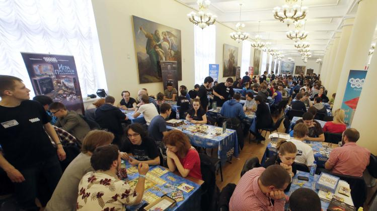 People play board games during a festival in St. Petersburg