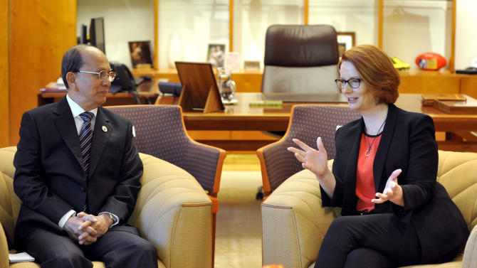 President of Myanmar Thein Sein, left, meets with Australian Prime Minister Julia Gillard at Parliament House in Canberra, Australia, Monday, March 18, 2013. Thein is on a three day visit to Australia.  (AP Photo/Alan Porritt, Pool)