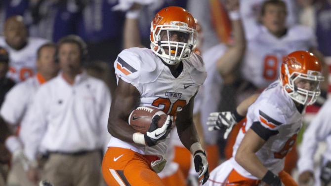 Oklahoma State running back Desmond Roland (26) returns a Kansas State kick for a touchdown during the first half of an NCAA college football game in Manhattan, Kan., Saturday, Nov. 3, 2012. (AP Photo/Orlin Wagner)