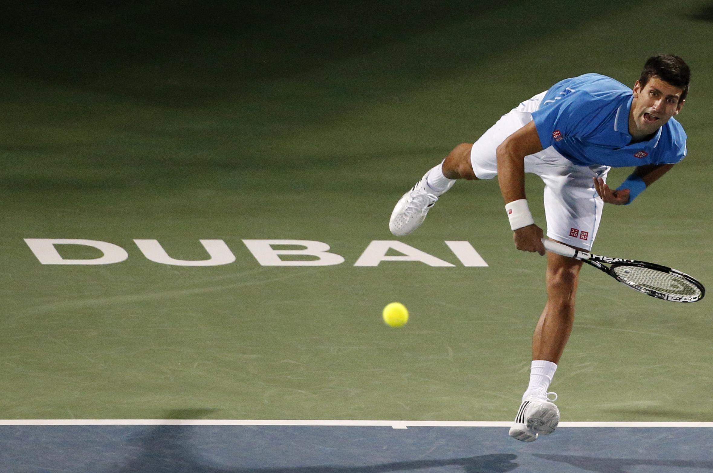 Djokovic earns Dubai showdown with Federer