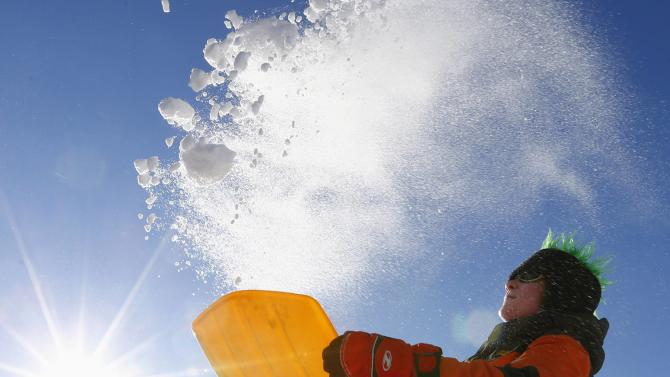 A boy plays in the freshly fallen snow at the Feldberg mountain, north-west of Frankfurt