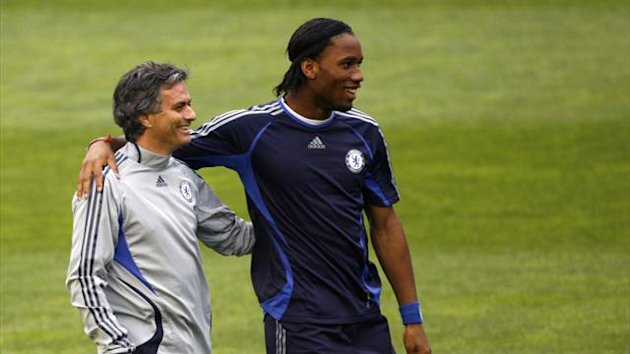 Fromer Chelsea manager Jose Mourinho (L) and Didier Drogba smile during a training session (Reuters)