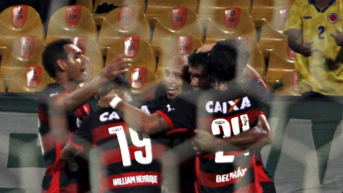 Ednei of Brazil's Vitoria celebrates with team mates after scoring against Atletico Nacional of Colombia during their Copa Sudamericana match in Medellin