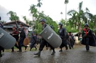 Police patrol the streets amid ongoing violence in Sittwe, capital of Myanmar's western state of Rakhine, on June 12, 2012. Under the former junta that ruled the country also known as Burma for almost half a century, any sign of unrest was quickly quelled by soldiers rather than the police