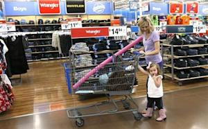 A woman shops with her daughter at a Walmart Supercenter in Rogers