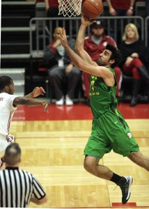 Singler leads No. 23 Oregon past WSU 79-77 in OT