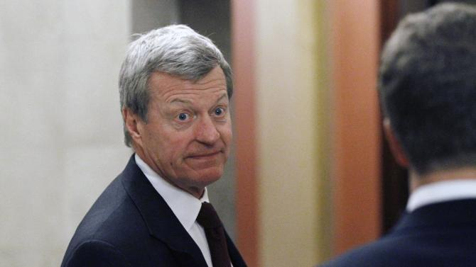 FILE - In this Dec. 1, 2010 file photo, Sen. Max Baucus, D-Mont., enters the Speaker's office for a meeting about tax cuts on Capitol Hill in Washington. President Barack Obama's push for tougher gun measures and expanded background checks has placed several moderate Senate Democrats facing re-election next year in a bind, forcing them to take sides on a deeply personal issue for rural voters. Baucus, the only Democrat with the NRA's top rating, said he will vote against the bill as it currently stands, Friday, April 12, 2013. (AP Photo/Alex Brandon, File)
