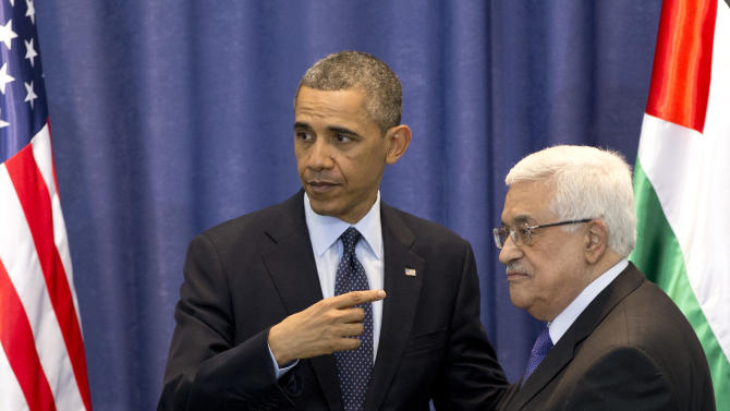 U.S. President Barack Obama, left, and Palestinian President Mahmoud Abbas, leave after a joint news conference at the Muqata Presidential Compound, in the West Bank town of Ramallah, Thursday, March 21, 2013. (AP Photo/Carolyn Kaster)