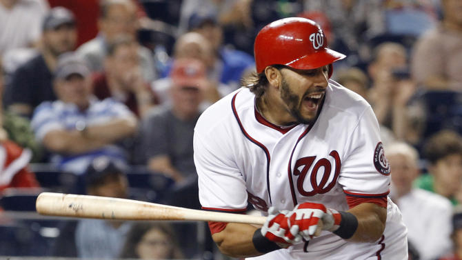 Washington Nationals' Michael Morse reacts after getting hit by a pitch from St. Louis Cardinals reliever Fernando Salas during the 10th inning of a baseball game in Washington, Thursday, June 16, 2011. The Nationals beat the Cardinals 7-4. (AP Photo/Ann Heisenfelt)