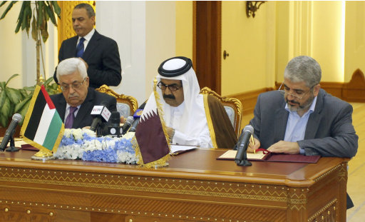 Palestinian President Mahmoud Abbas, left, Emir of Qatar Sheikh Hamad bin Khalifa Al Thani, center, and Hamas leader Khaled Meshaal, right, sign an agreement in Doha, Qatar, on Monday, Feb. 6, 2012.  The main Palestinian political rivals on Monday took a major step toward healing their bitter rift, agreeing that Palestinian President Mahmoud Abbas would head an interim unity government to prepare for general elections in the West Bank and Gaza Strip. (AP  Photo/Osama Faisal)