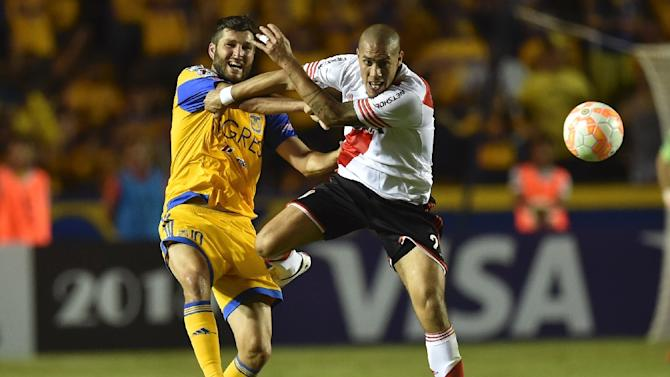 River Plate's Jonathan Maidana (R) clashes with Tigres's Andre Gignac during their Copa Libertadores final match, first leg, in Monterrey, Mexico on July 29, 2015