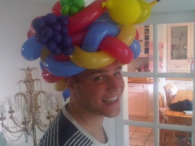 Celebrity photos: Olly Murs joked on Twitter this week that he'd ditched his trademark trilby hats for a new form of headgear, in the shape of a balloon hat. He posted this image along with the captio