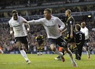 Tottenham Hotspur&#39;s Kyle Walker (C) celebrates scoring his goal with teammate Louis Saha during their English FA Cup quarter-final match against Bolton Wanderers at White Hart Lane in north London, on March 17. Tottenham advanced to the semis where they will play Chelsea, on Sunday