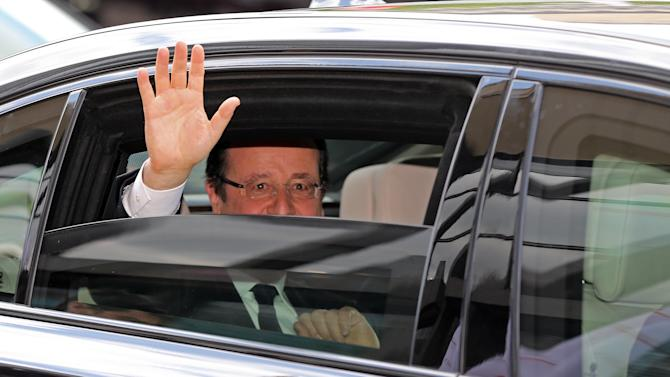 French President Francois Hollande leaves the ceremony to mark the 150th birthday of the Social Democratic Party of Germany (SPD) at the Gewandhaus in Leipzig, Germany, Thursday  May 23,  2013. (AP Photo/dpa, Jan Woitas)