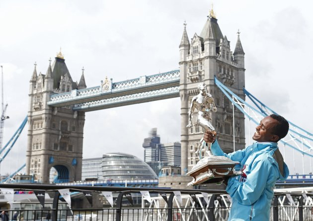 London Marathon winner Tsegaye Kebede of Ethiopia posees with the winners trophy at Tower Bridge in London