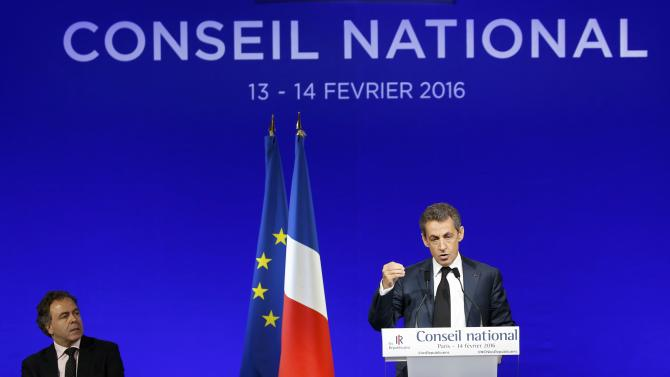 Nicolas Sarkozy, head of France's Les Republicains political party and former French president, and Luc Chatel attend their party's national council in Paris