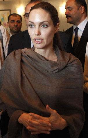 United Nations High Commissioner for Refugees (UNHCR) special envoy, Angelina Jolie starts a visit to Baghdad, Iraq, Saturday, Sept. 15. Jolie said Friday that with winter approaching, she is concerned about the plight of hundreds of thousands of Syrians forced to flee their homes. (AP Photo/Karim Kadim)