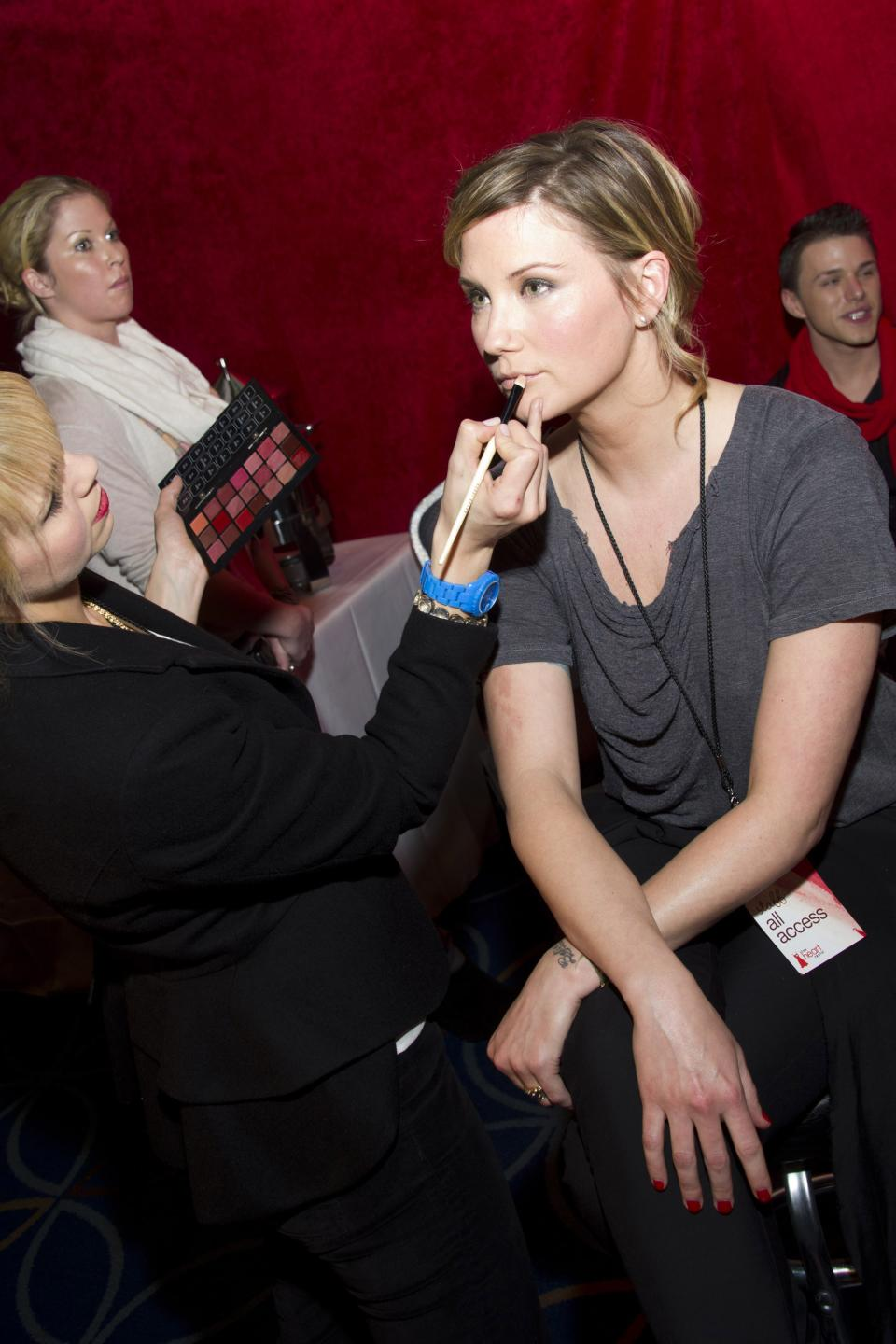 Singer Jennifer Nettles appears backstage at the Heart Truth's Red Dress Collection during Fashion Week in New York, Wednesday, Feb. 8, 2011. (AP Photo/Charles Sykes)
