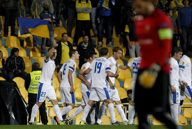 Liberec's Josef Sural, left, celebrates with teammates after scoring past Estoril's goalkeeper Vagner Silva, unfocused front right, during a Europa League group H soccer match between Liberec