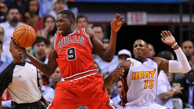 Chicago Bulls small forward Luol Deng (9) fouls Miami Heat point guard Mario Chalmers (15) during the second half at American Airlines Arena. Miami won 107-95 (Reuters)