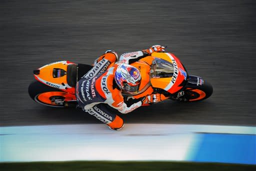 World Champion MotoGP rider Casey Stoner from Australia, steers his Honda for Sunday's Portugal Motorcycle Grand Prix, at the Estoril racetrack in Sintra, outside Lisbon, Saturday, May 5, 2012. Stoner clocked the fastest time to take pole position. (AP Photo/Alvaro Barrientos)
