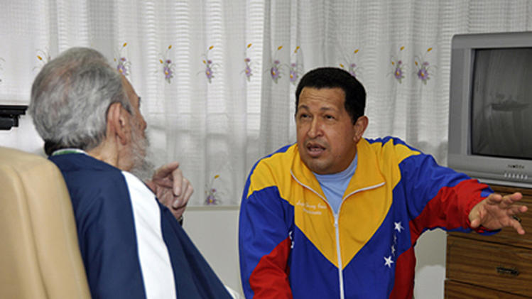 In this photo downloaded from the state media Cubadebate web site, Cuba's Fidel Castro, left, pays a visit to Venezuela's President Hugo Chavez at a hospital in Havana, Cuba, Friday June 17, 2011. Chavez underwent surgery in Cuba for a pelvic abscess Friday. (AP Photo//Cubadebate)