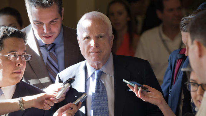 Sen. John McCain, R-Ariz., is surrounded by reporters as he and other lawmakers walk to a closed-door meeting in the Old Senate Chamber for a showdown between Republican and Democratic leaders over presidential nominees that have been blocked by a GOP filibuster, at the Capitol in Washington, Monday, July 15, 2013. Senate Majority Leader Harry Reid insisted in advance that Republicans permit yes-or-no confirmation votes on all seven of the nominees at issue. If they won't, he declared, Democrats will change the Senate's rules to strip them of their ability to delay. (AP Photo/J. Scott Applewhite)