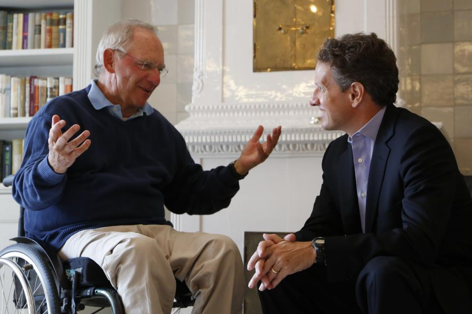 German Finance Minister Wolfgang Schaeuble, left, speaks with U.S. Treasury Secretary Timothy Geithner, right,  in the house where Schaeuble is vacationing, in Westerland on the North Sea island of Sylt, Germany  Monday July 30, 2012. (AP Photo/dapd/ Philipp Guelland)