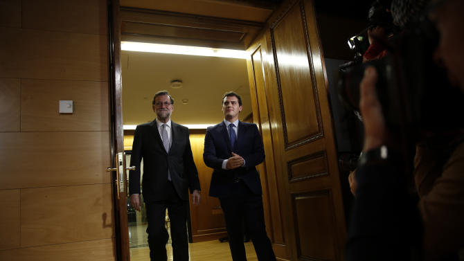 Spanish acting PM Rajoy and Ciudadanos party leader Rivera arrive for their meeting at the Spanish Parliament in Madrid