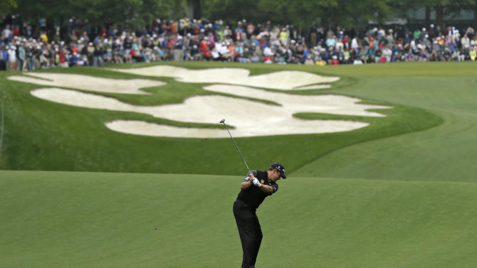 Lee Westwood, of England, hits his approach shot to the fifth green during the first round of the Wells Fargo Championship golf tournament at Quail Hollow Club in Charlotte, N.C., Thursday, May 2, 2013. (AP Photo/Chuck Burton)