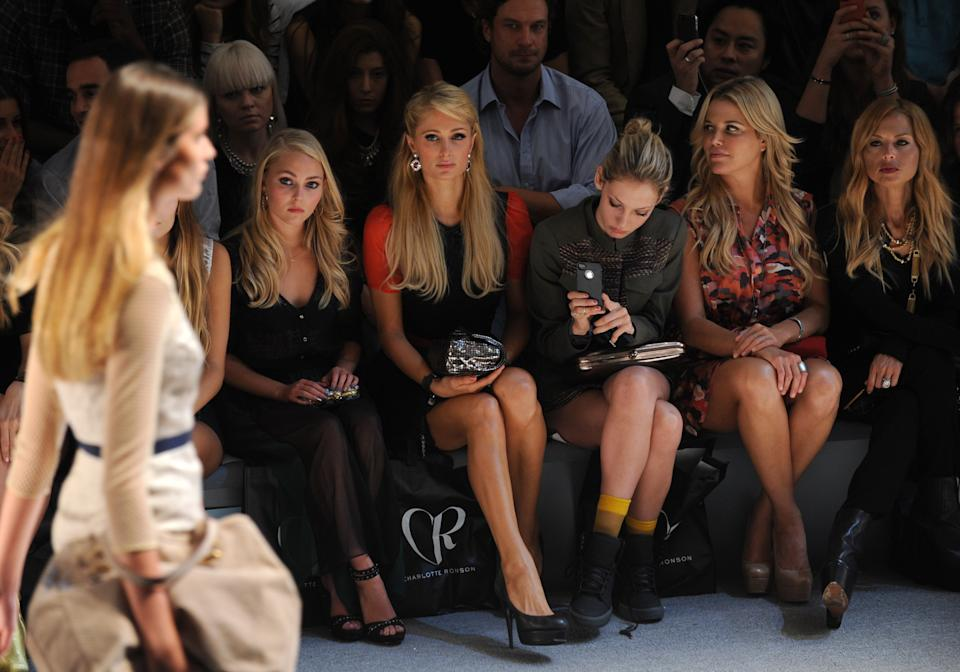 Celbrities, seated from left, AnnaSophia Robb, Paris Hilton, Cory Kennedy, Ali Wise and Rachel Zoe attend the Charlotte Ronson spring 2013 show, Friday, Sept. 7, 2012 in New York. (Photo by Diane Bondareff/Invision/AP)